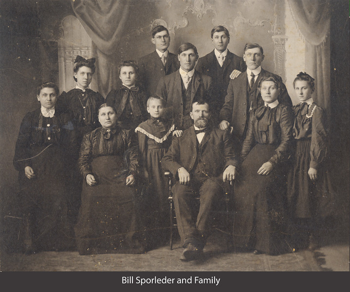 Bill Sporleder Family.  They lived in Pierce Nebraska.  Ella is standing between them. The man on the far right of the middle row is John.