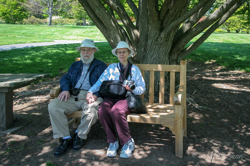Picked up Tom & Pat in Palmyra, visited Hershey Gardens, had lunch at Hotel Hershey; gardens opened 1937 as 3.5-acre rose garden, enlarged to current 23 acres by 1941; children's garden & other themed areas developed over time; gardens, at 170 Hotel Rd, lie S of Hotel Hershey & N of Hershey Park amusement park; in main garden area, a central N-S walkway runs between flag pole at N end & irregular pond with fountain at S end; square gazebo on walkway & flanking E-W hedge row divide rose beds on S from tulip beds on N; tulips were great on this visit, roses just emerging from winter; on NE side of main formal area lie some informal plantings of azaleas, etc., & various trees; Tom & Pat in the informal area of garden; just 1 map pin for all shots in informal area - cannot place better than this, 10 years after visit