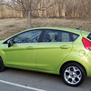 Patti's new 2011 Ford Fiesta!  That lovely color is called Lime Squeeze Metallic...you either love it or hate it (Patti is in the former camp), but it certainly is eye-catching!  December 2010