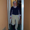 Jeane models her boot and crutches -- a side effect of treatment for plantar fasciitis.  Winter 2009