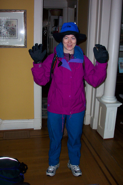 Being in training for Grandma's Marathon means that Patti can't skip a long run, even when it rains all weekend.  She's garbed in gore-text from head to toe and her cast is well protected.  2/15/2003