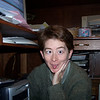 Patti - on the floor by the computer.  It's never a good time when Patti is needing to mess with the hardware and wires.  November, 2004