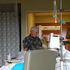 Expectant Granddad, Don, checks out the status of baby Ella's heart rate on the monitor during a contraction.