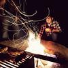 Lamar tending the fire at Kirby Cove.