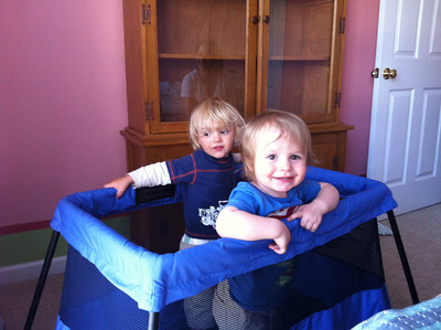 Luca showing Cedar his travel crib.