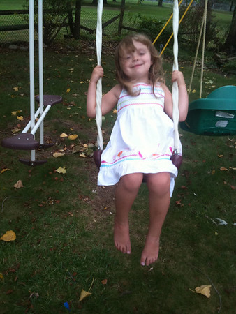 Olive Happily Swinging.