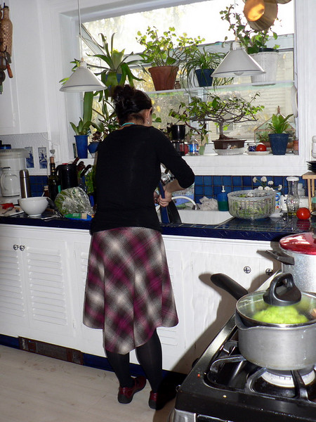 Zhao Li helping in the kitchen.