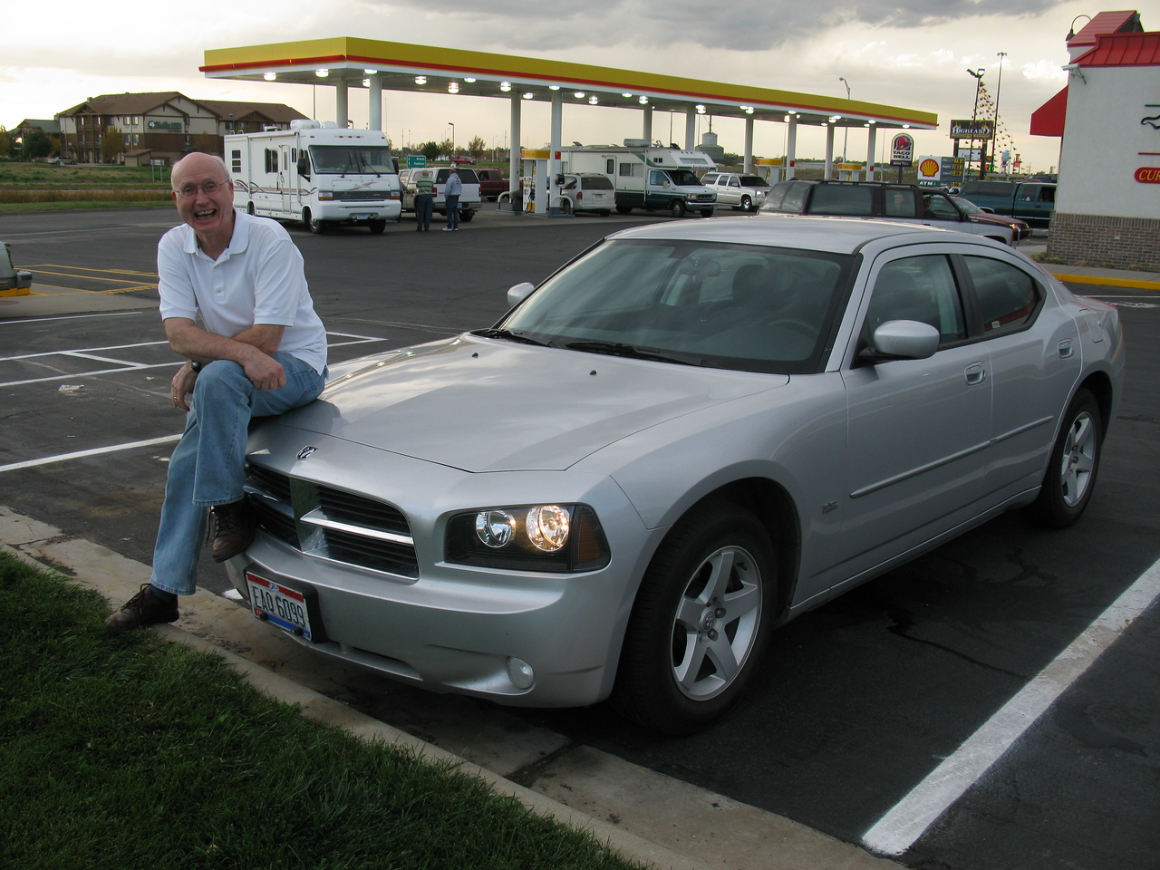 Muscle man with his muscle car...a Dodge charger. Just want to be like you, Gordy & Peggy!<br /> October 9, 2010