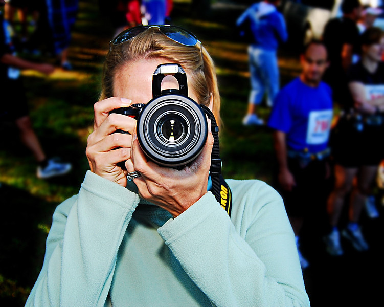The Competition.  The day Amp buys her a Nikon D3, I'm throwing in the towel.