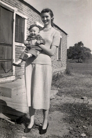 Norma Wright holding baby Gary. 1952. I believe the location is at George (Sr) and Gladys Wright's place on Cedarbrook, just east of Springfield.