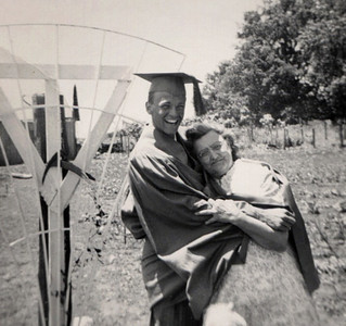 George Junior Wright in graduation cap and gown with Millie Lemons, his grandmother. May 27, 1949.