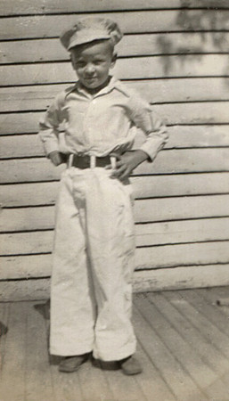 George Junior Wright as a child in a sailor's uniform.