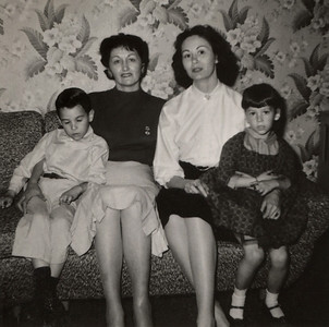From left, Gary, Hazel, Norma and Cara; March 1958. Florid wallpaper pattern suggests location may be at George and Norma's house on Clay Avenue in Springfield(?)