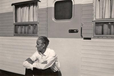 Roscoe Davenport, sitting beside his trailer.