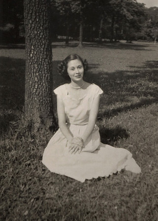Written on back of photo: Norma Davenport, Summer 1949. Lavender cotton dress with scalloped neck, sleeves & hem made by Hazel.