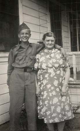 George Junior Wright in Scout uniform with Millie Lemons, his grandmother.