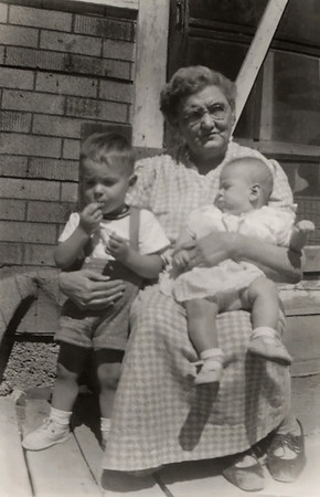 Gary and Cara Wright sitting in the lap of their great grandmother, Millie Lemons. November, 1953.
