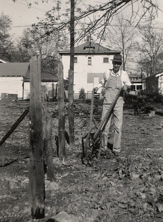 George William Wright pushing a cultivator.
