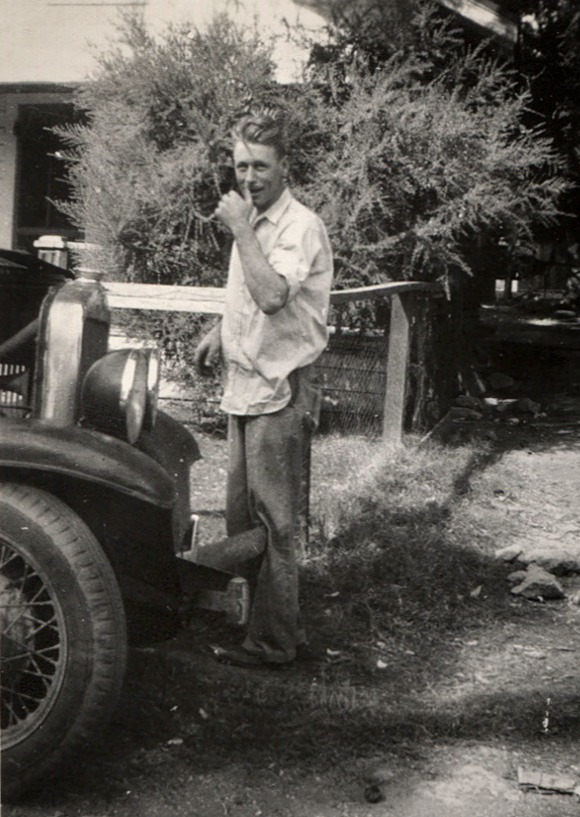 George William Wright in front of an old car.