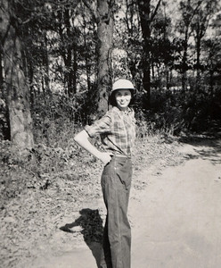 Norma Jean standing on a sunny road. Appears to be early 1950s.