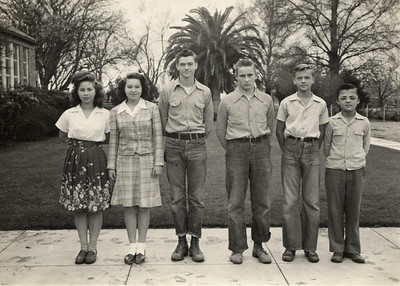 8th grade graduating class, Grimes California, 1945. George Junior Wright is second from right.