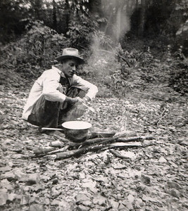 George William Wright cooking on a camp fire.