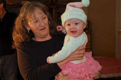 Cara holding baby Chloe. Christmas at Norma's; 12/18/2011.