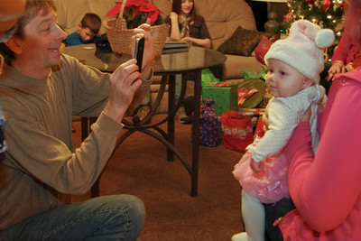 David, photographing baby Chloe; Christmas at Norma's; 12/18/2011.