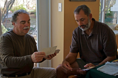 Larry and Kevin Look at photos; Thanksgiving at Ritas. 2011