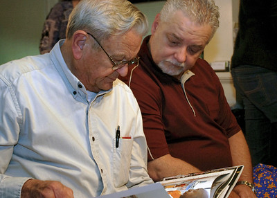 George and Keith look at a book. Christmas at Norma's; 12/18/2011.