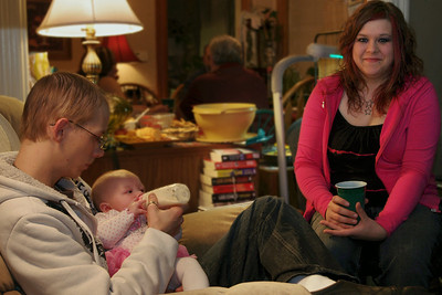 Brandon, baby Chloe, and Mindy. Christmas at Norma's, 2011.