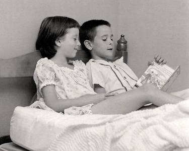 Cara and Gary reading a story book. 1959 Scan is from a Polaroid print made by George Wright.