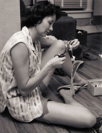 Norma, cutting out paper dolls. 1959 Scan is from a Polaroid print made by George Wright.