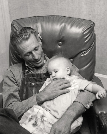 George Wright Sr holding baby Lisa. 1959 Scanned from a Polaroid print made by George Junior Wright.
