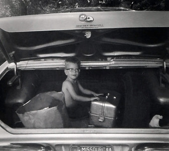 David Wright in the trunk of a car. November 1965.