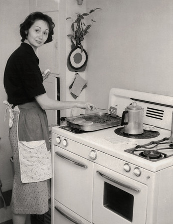 Norma in her kitchen. About 1959 Scan is from a Polaroid print made by George Wright.
