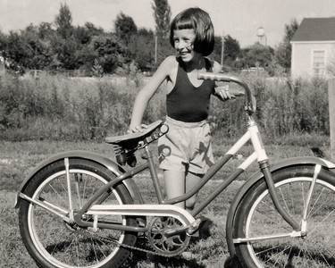 Cara with her first bicycle. 1959 Scan is from a Polaroid print made by George Wright.