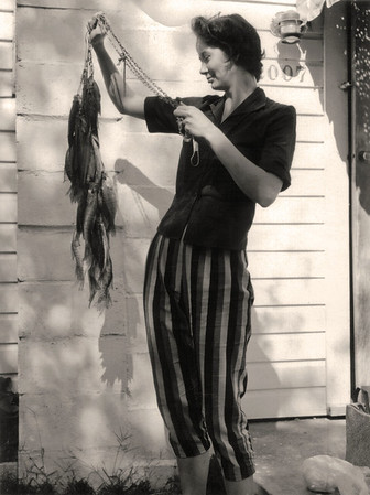 Norma, holding a stringer of fish. About 1959 Scan is from a Polaroid print made by George Wright.