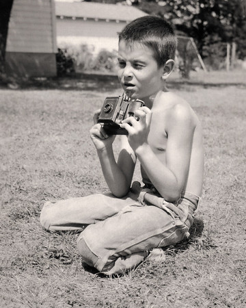 Gary with his first camera. 1959 Scan is from a Polaroid print made by George Wright.