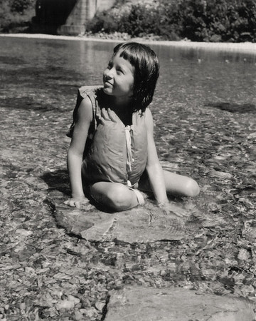 Cara, sitting in Swan Creek near Garrison, Missouri. 1959 Scan is from a Polaroid print made by George Wright.
