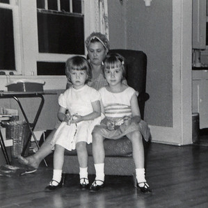 Dana and Lisa Wright, sitting in the lap of their grandmother, Gladys Wright, June, 1964.