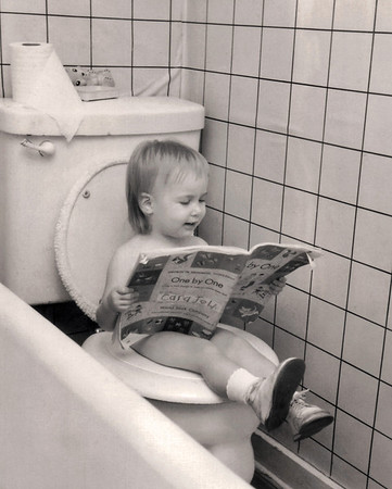 Lisa enjoys some light reading while potty training. 1960 Scan is from a Polaroid print made by George Wright.