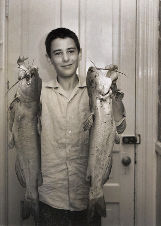 Gary holding two catfish. Scan is from a B&W Polaroid taken in 1965.