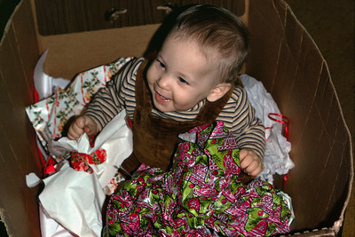 Sean Melton in a box of Christmas wrapping paper. 1974