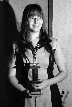 Lisa Wright holding her trophy in Gary and Rita's house on North National. About 1975.