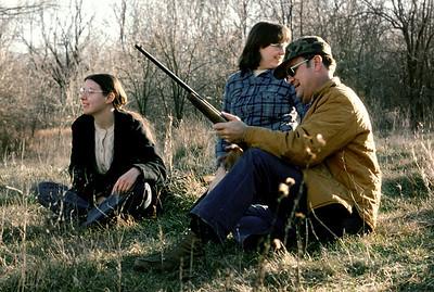 Rita Wright, Lisa Wright and George Junior Wright shooting skeet. Late Fall, 1975.