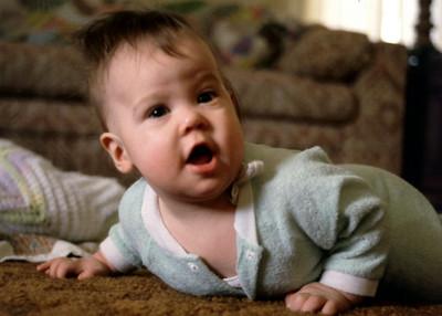 Baby Olivia Morris crawls on the carpet at Grandmas Norma's. 1979.