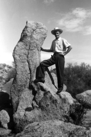 Roscoe Davenport posing beside a rock in the desert. Location and date unknown. Photo provided by Norma Wright.