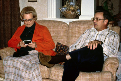 Dorothy Anderson and her brother, George Wright look at pictures on the couch at Norma's. 1979.