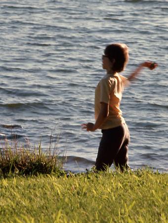 David Wright throwing rocks in Fellows Lake. June, 1974.